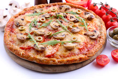 Tasty pizza with vegetables and arugula close up