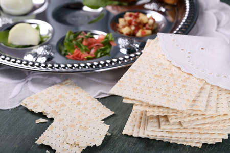 Matzo for Passover with Seder meal on plate on table close up Banco de Imagens