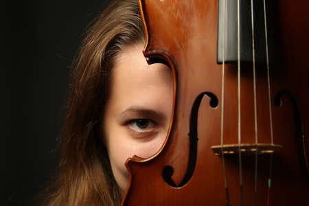 Female portrait with violin, closeup