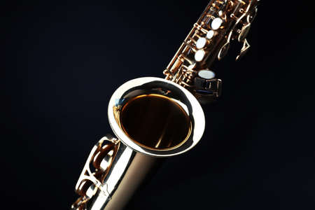 Golden saxophone on dark background Stock Photo