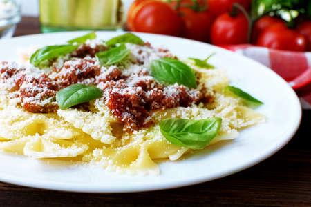 Pasta bolognese in white plate, closeup