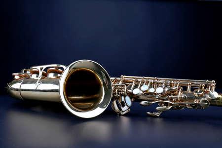Golden saxophone on dark background Stock Photo