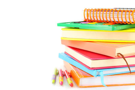 Stack of books and stationery isolated on white Stock Photo