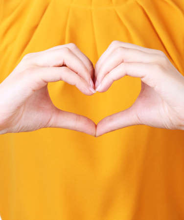 Girl with her hands in heart-shaped Stock Photo