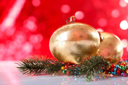 Beautiful Christmas balls on red blurred background Stock Photo