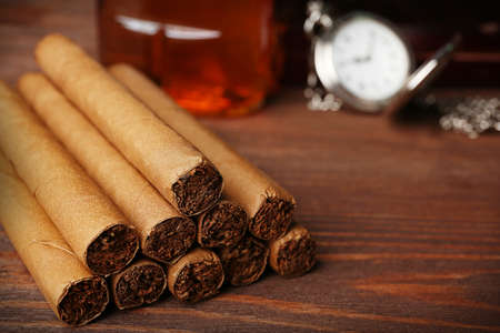 Cigars on wooden table, closeup Stock Photo