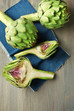 Artichokes on wooden background Banco de Imagens