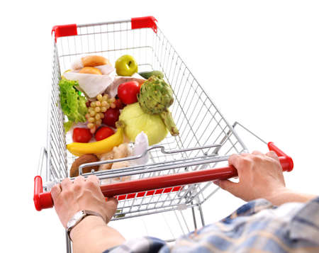 Young man with shopping cart isolated on white