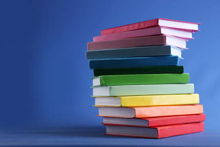 Colorful books on blue background Stock Photo