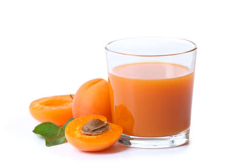 Glass of apricot juice isolated on white Archivio Fotografico