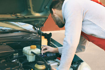 Auto mechanic repairing car at service station Stock Photo