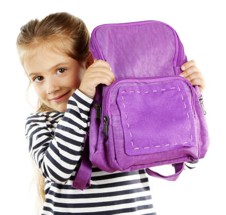 Beautiful little girl holding backpack isolated on white Stock Photo
