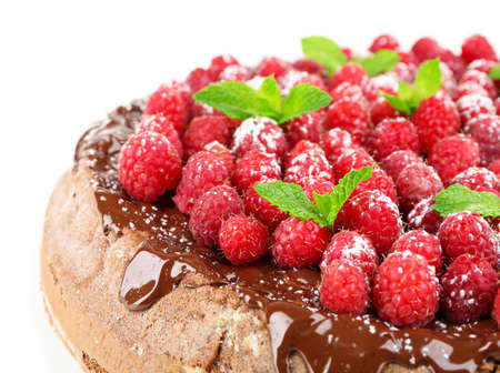 Cake with Chocolate Glaze and raspberries isolated on white