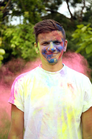 Young man on Holi color festival in park