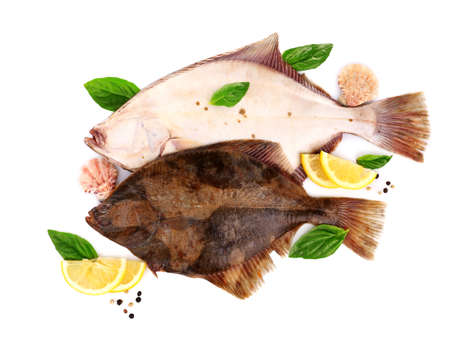 Fresh fishes with spices isolated on white