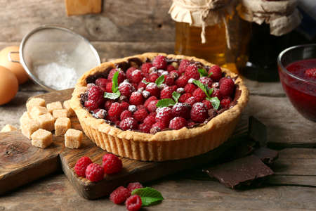Tart with fresh raspberries, on wooden background Stock Photo