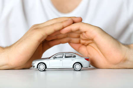 Male hands and car as protection of car concept Stockfoto