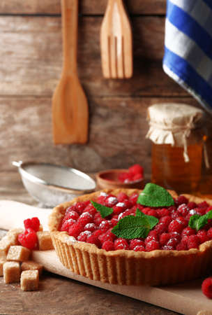 Tart with fresh raspberries, on wooden background Stock Photo