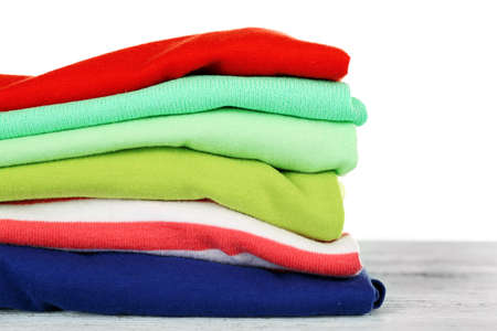 Stack of colorful clothing isolated on white