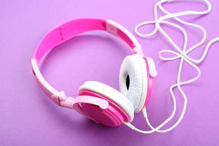 Headphones on purple background