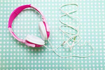 Headphones on stars background Stock Photo