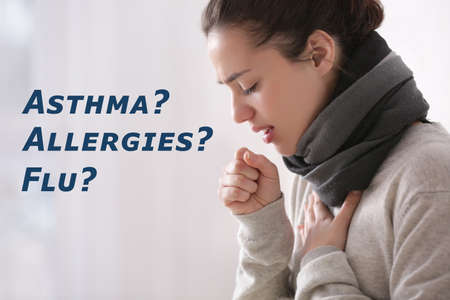 Young woman suffering from cough as symptom of asthma, allergies or flu on color background Stock Photo
