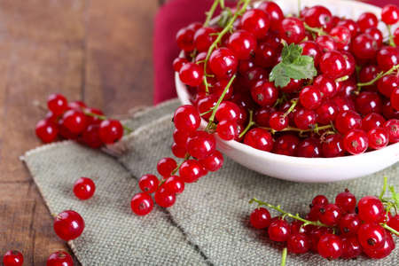 Fresh red currants in bowl on table close up Stock Photo
