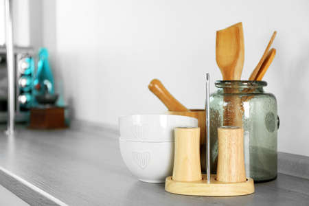 Composition with different utensils on wooden wooden table in kitchen Reklamní fotografie - 93403523