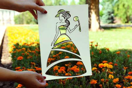 Female hand holding fashion sketch outdoors Archivio Fotografico