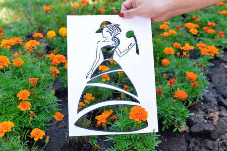 Female hand holding fashion sketch outdoors Stock Photo