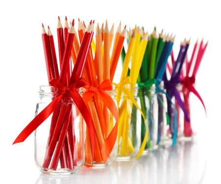 Bright pencils in glass jars, isolated on white