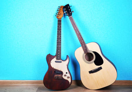 Guitars on blue wallpaper background