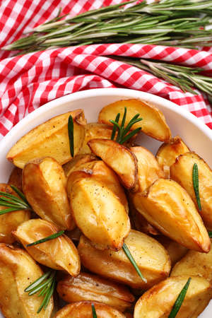 Baked potato wedges on table, closeup
