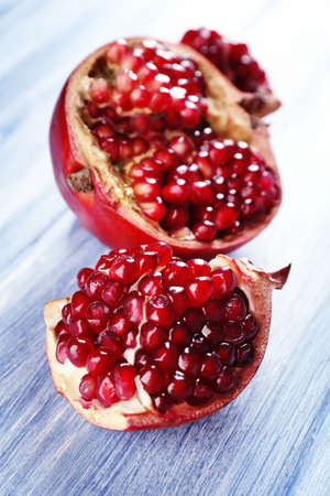 Fresh ripe garnet on wooden table close up