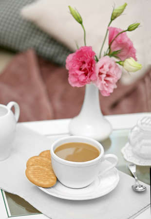 Cup of coffee on table in living room Stock Photo