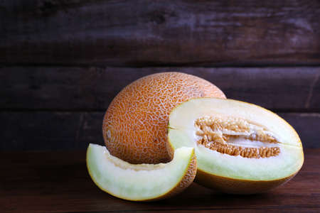 Ripe melon on wooden background