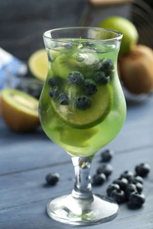 Kiwi and Blueberry cocktail on wooden background