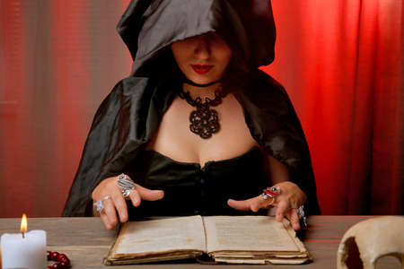 Witch - fortune teller on color background Archivio Fotografico