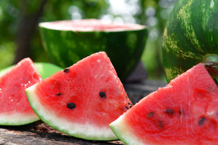 Fresh watermelon on stump of tree, closeup Stock Photo
