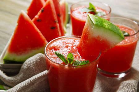 Glasses of watermelon juice on sackcloth, closeup