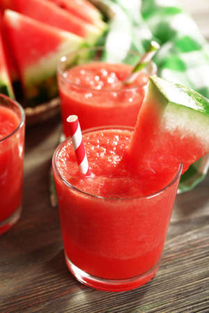 Glasses of watermelon juice on wooden table, closeup Stock Photo