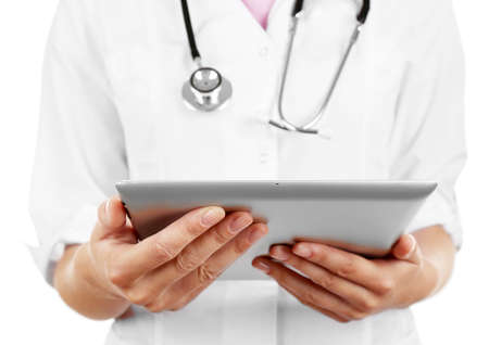 Female doctor working on digital tablet isolated on white