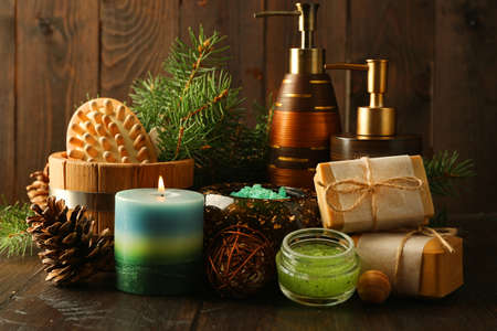 Essential oil of pine, handmade soap and cream with pine extract and spa treatments on wooden background Stock Photo