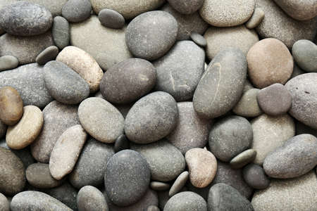 Gray sea pebbles background Stock Photo