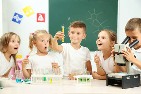 Cute pupils doing biochemistry research in chemistry class Banco de Imagens - 102164351