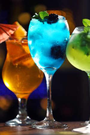 Glasses of cocktail on dark blurred lights background