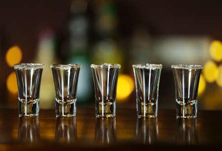 Empty shot glasses on bar counter