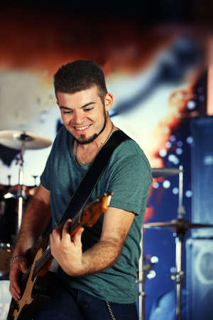 Young man playing on electric guitar at pub Stock Photo