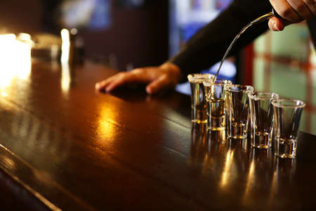 Bartender is pouring tequila into glass Stock Photo