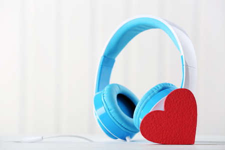 blue headphones with heart on unfocused background Stock Photo